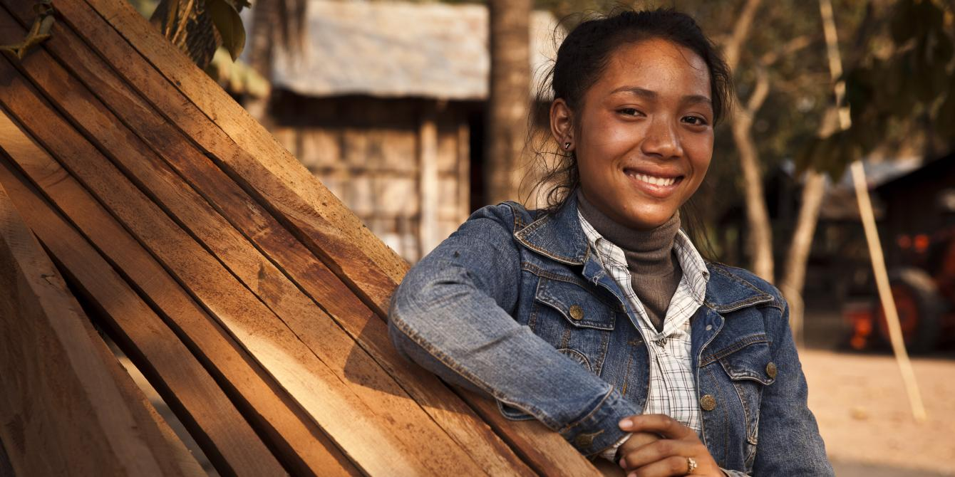 Da Sophea, 18, is a member of a Saving for Change group, and after she attended a business training program she decided to expand her road-side food and drink stand