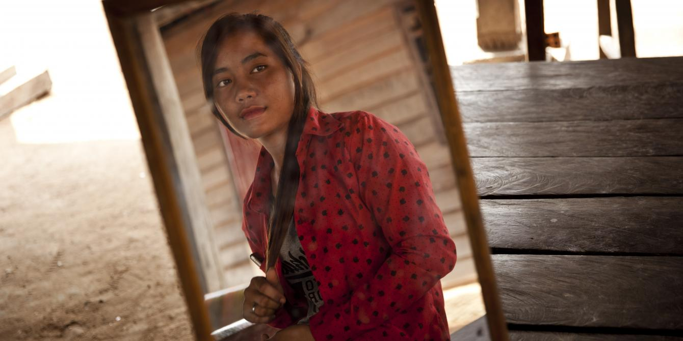 Salout Louy, 19, is a member of a Saving for Change group with more than 20 members.