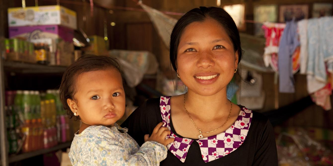 Plen Soben, 25, with her two-year-old daughter, runs a small store and restaurant in a village called Kouk Sangkerch