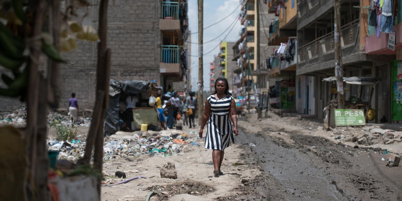 Elizabeth Wayua, 31, a domestic worker arrives at her employer's house to start her chores in Pipeline, Embakasi, Nairobi, Kenya. 2016. Photo Credit: Allan Gichigi