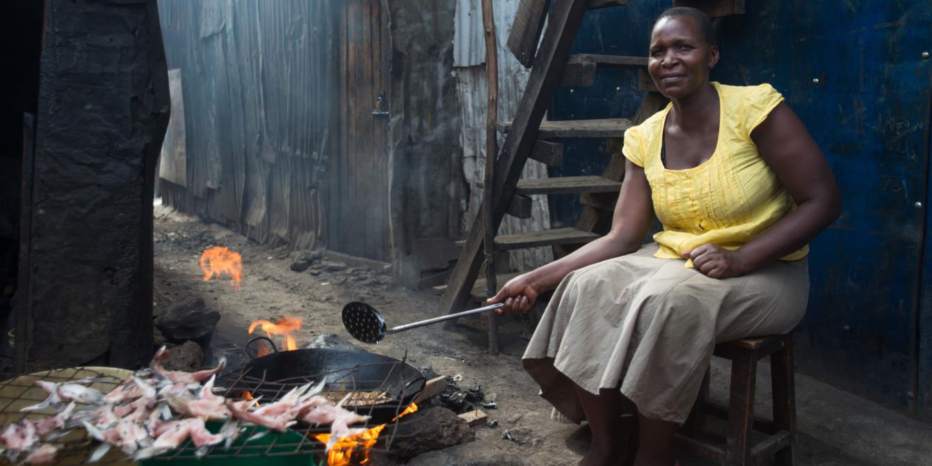 Zipporah Kwamboka preparing fish for her business in Mukuru informal settlements, Nairobi, Kenya.  She has benefited from Oxfam Cash transfer for work program. Photo Credit: Allan Gichigi / Oxfam