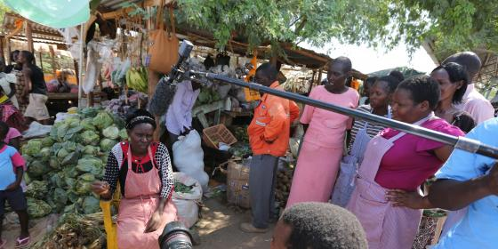 Women in Lodwar market engaging in a live radio show on oil and community rights. Photo Credit: LightBox Limited