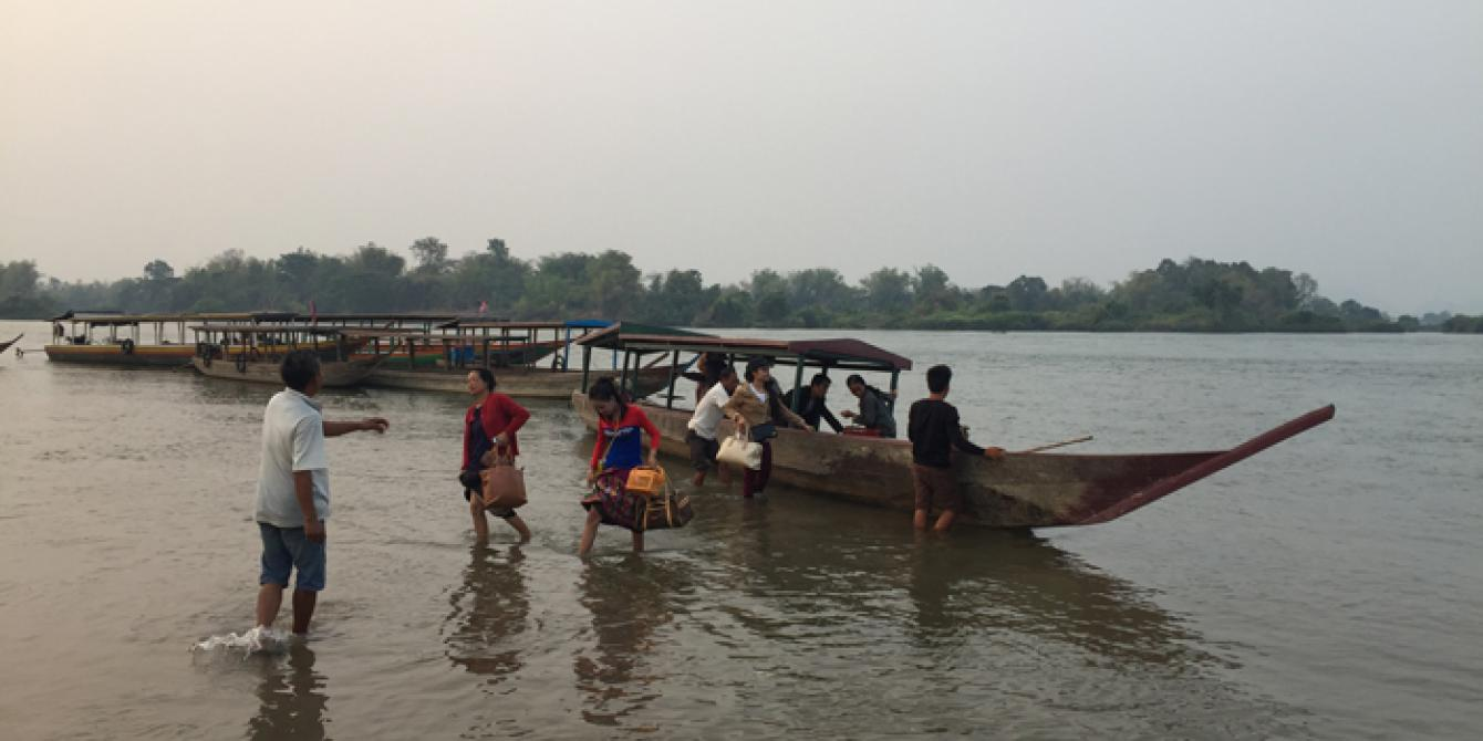 crossing the Mekong river by boat