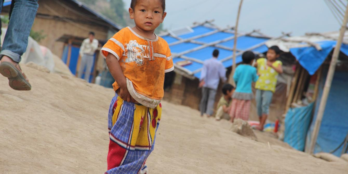 A child in Kachin IDPs camp standing on the road, Photo by: Yee Mon Oo/Oxfam