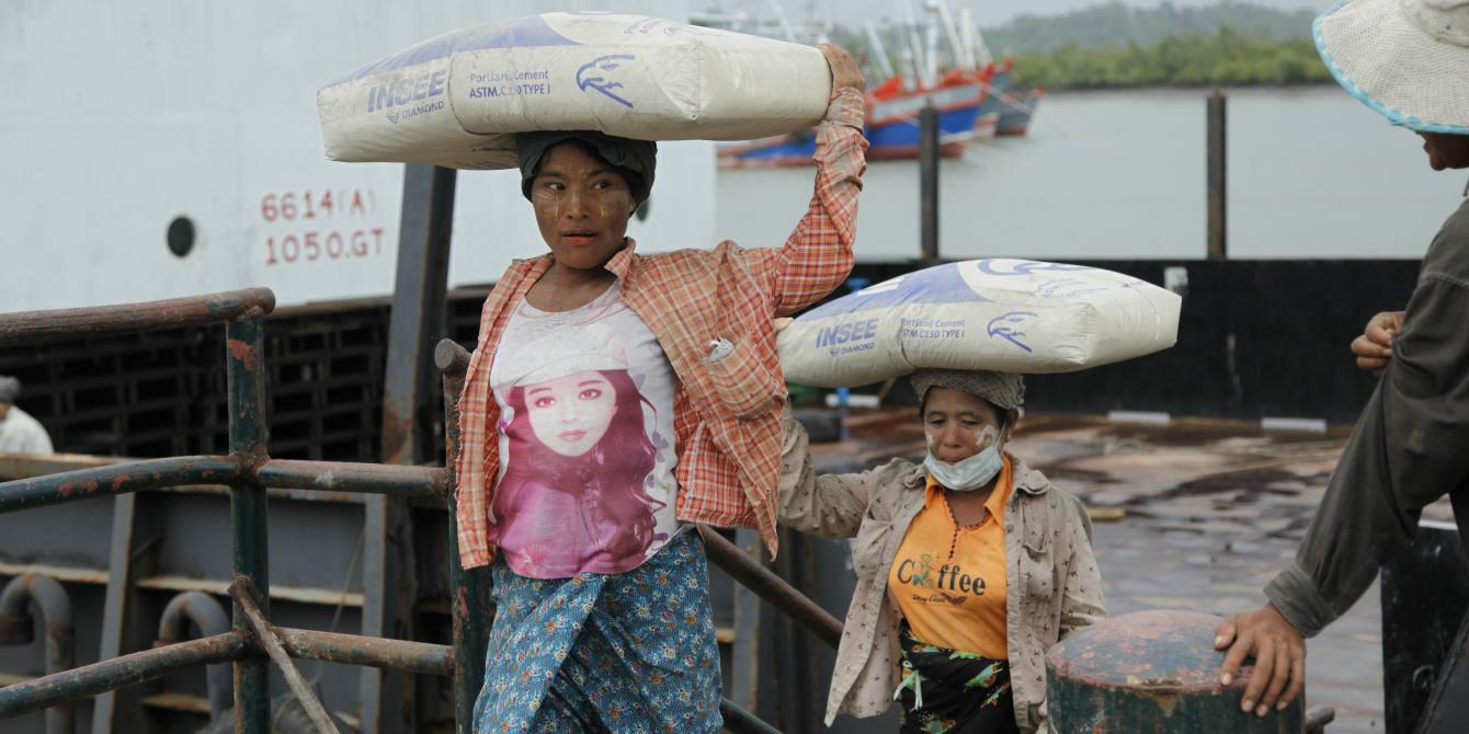 2 local women are carrying cement in Kyauk Phyu, Rakhine State