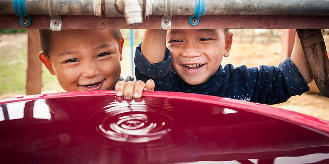 Children in IDPs camp in Kachin beside the water tank