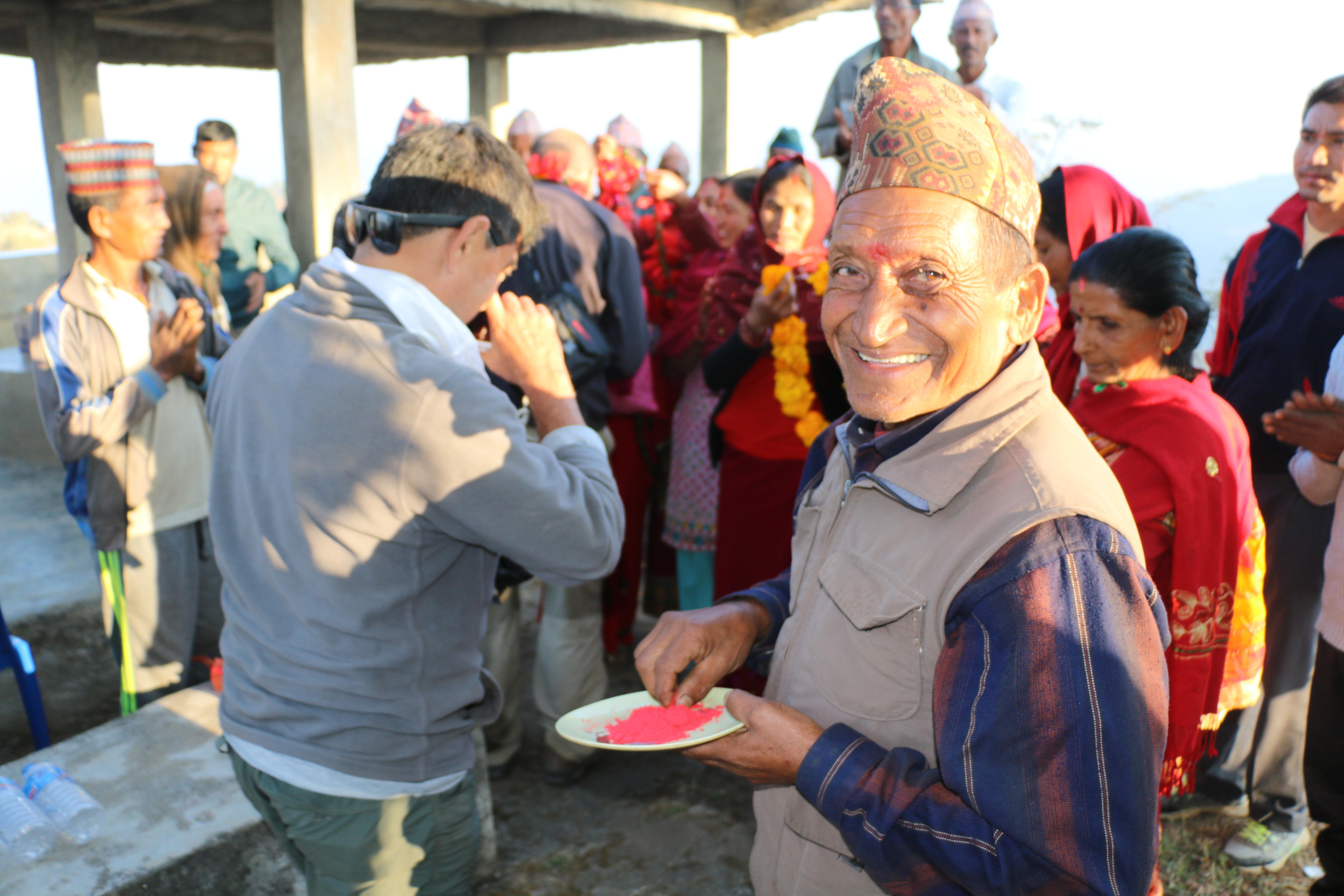 A smiling man in Kerauja
