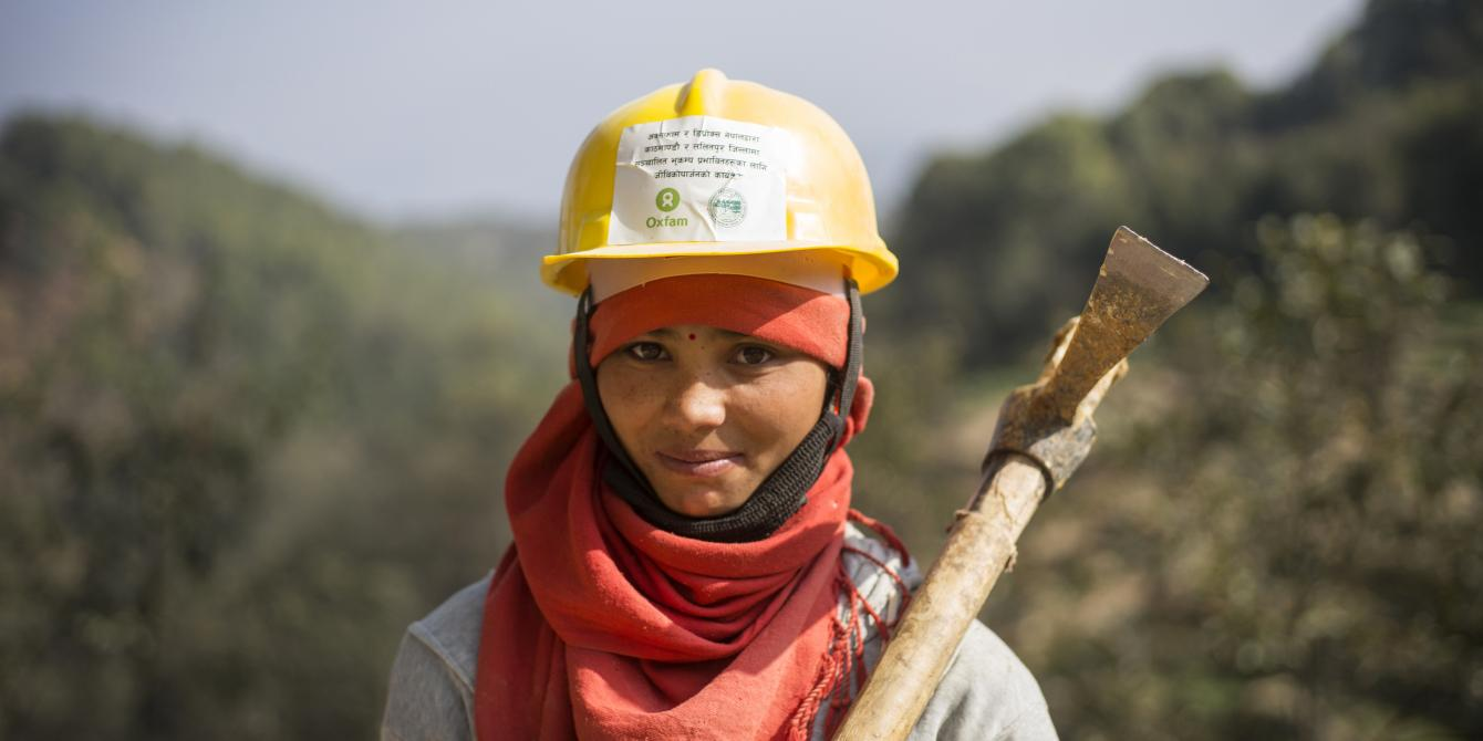 Bimala Balami participates in a Cash for Work programme in her hometown Dakchinkali, restoring an irrigation channel after the devastating earthquake of 2015 - Credit: Kieran Doherty/Oxfam