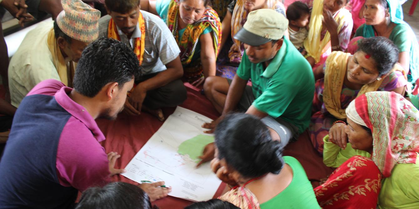 Community members prepare a village map as part of preparing by-laws - Credit: Rasna Dhakal/Oxfam