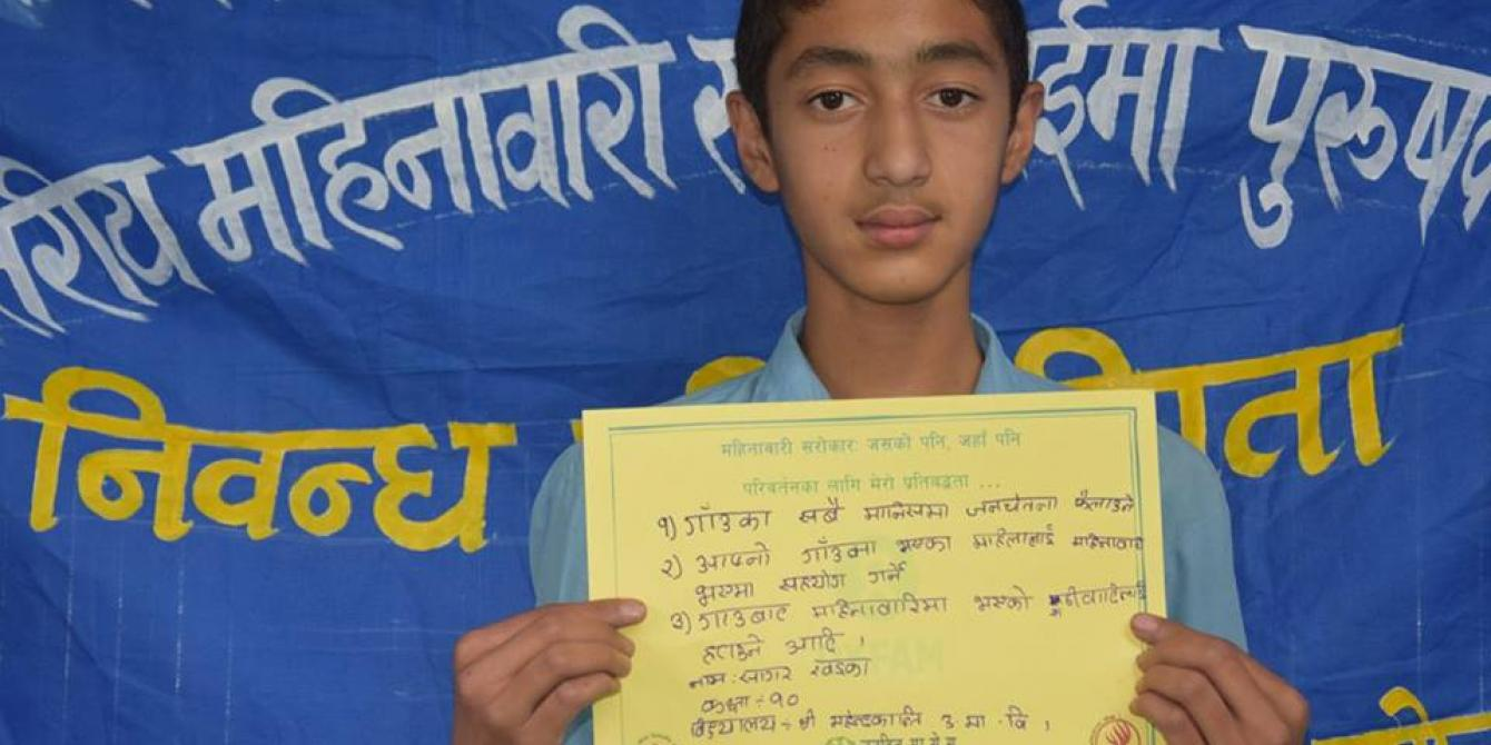 """Sagar Khadka, winner of the essay competition organized by Gramin Mahila Srijanshil Pariwar and Oxfam on """"Men in Menstruation"""" on the occasion of Menstrual Hygiene Day 2016 - Credit: Dipana Dhimal"""