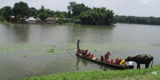 A wooden boat rescuing people