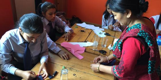 college students learn new skills to make alternate sanitary napkins