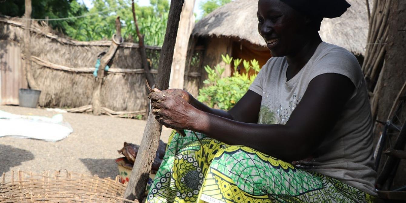 A female small scale farmer processing her farm yield