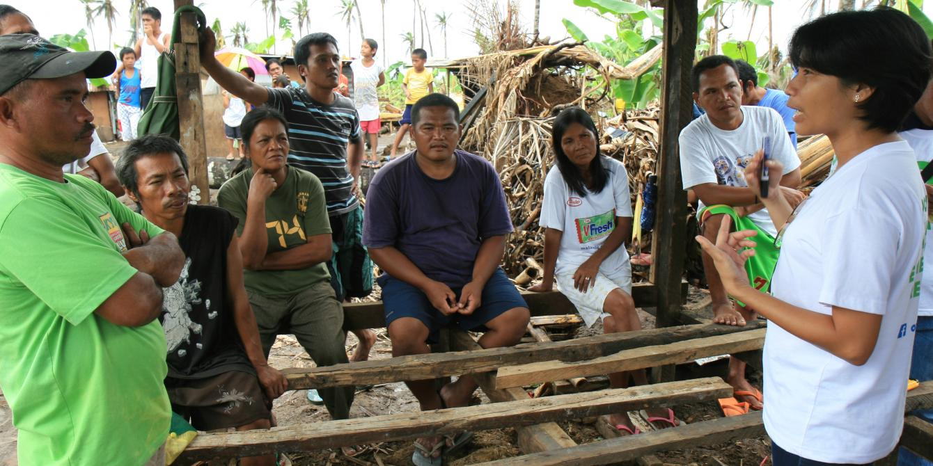 Oxfam Livelihoods Officer, Zenia Leysa, gives a presentation on setting up an income generating sawmill to the Lapay Tugop Farmers Association in Tugop, Tanauan, Leyte.(Photo: Jane Beesley/Oxfam)