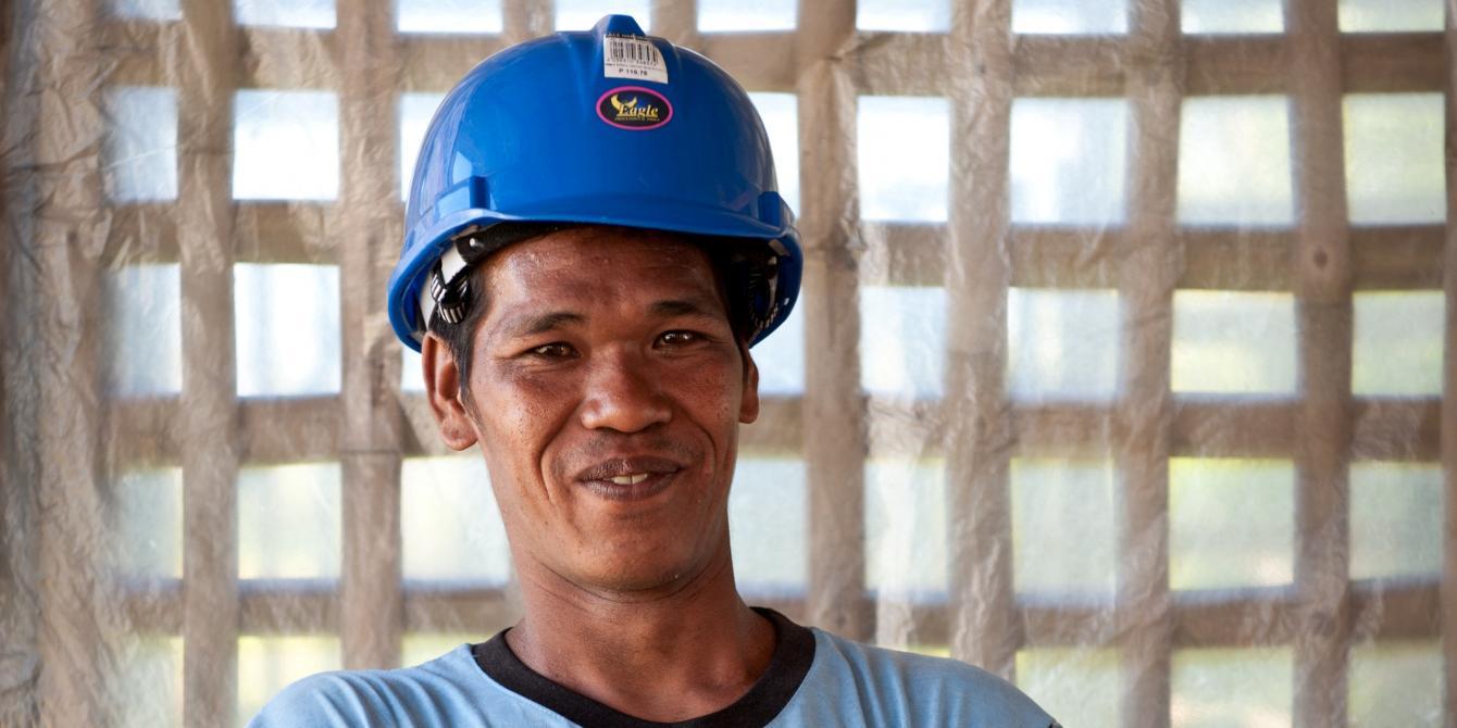 Roselito Mercado (27) Chainsaw Operator, Latufa Farmers' Association, Tugop, Leyte.  (Photo: Eleanor Farmer/Oxfam)