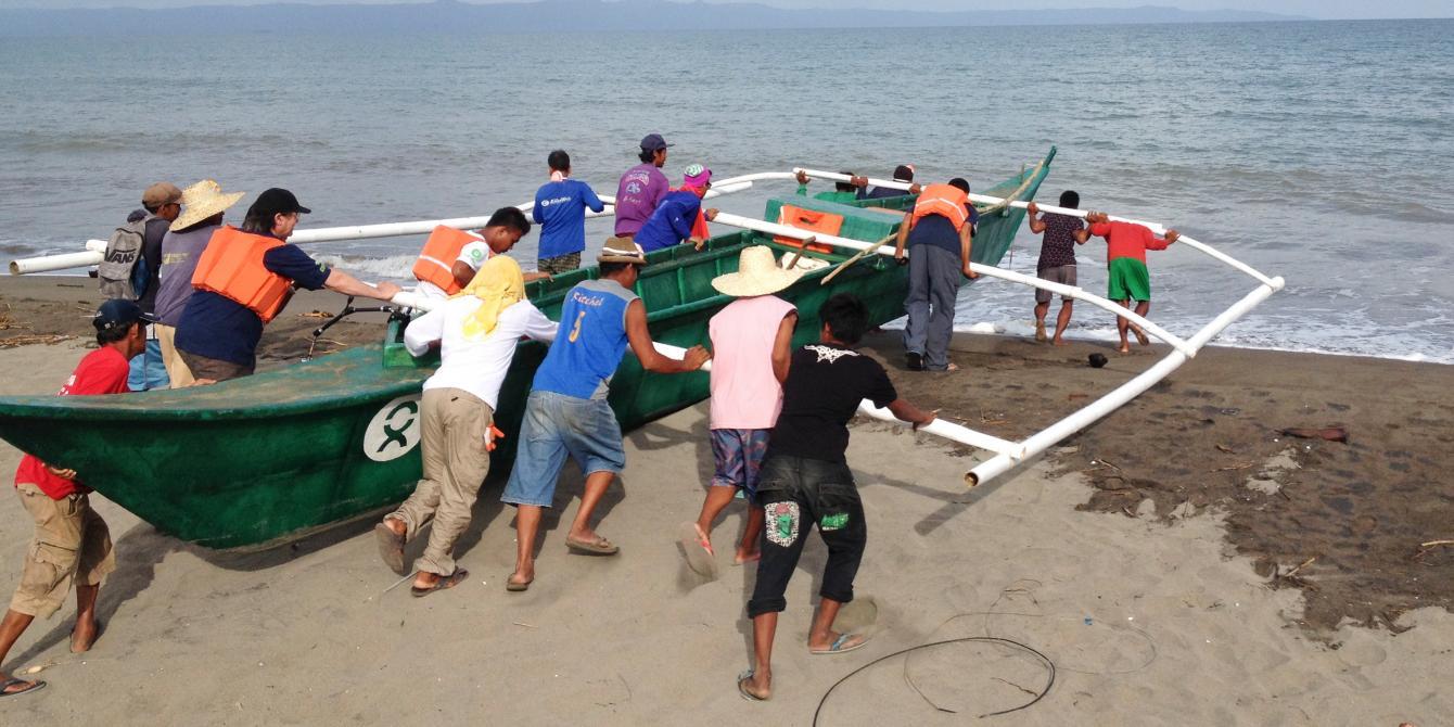 Fishermen launch newly-built fibreglass boat in Tacloban City (Photo: Carolyn Gluck/Oxfam)