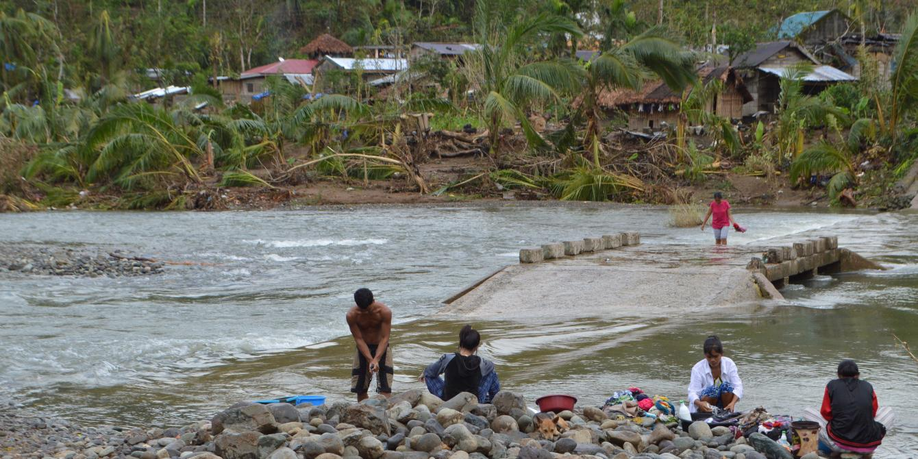 Residents of Barangay Dugui Too repairing their damaged houses