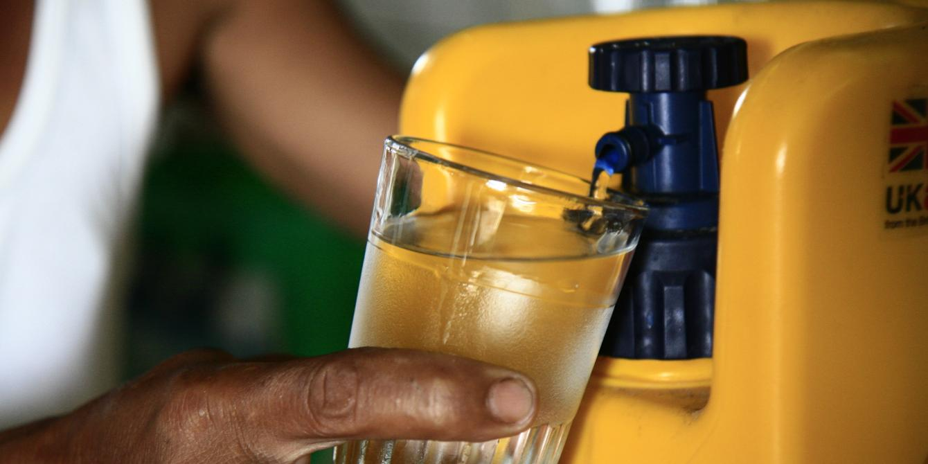 Oxfam, with support from UKAid, is distributing around 2,000 Lifesaver jerrycans as part of its response in Leyte. Lifesaver jerry cans can filter 10,000 to 20,000 litres (2,650 to 5,300 gallons) of water. One jerrycan can provide water for four people for over three years. It does not need chemicals as it uses carbon technology that filters out viruses and bacteria. The process of filtering takes around 20 seconds then 0.70 litres or around 1.5 pints can be drunk immediately. (Photo: Jane Beesley/Oxfam)