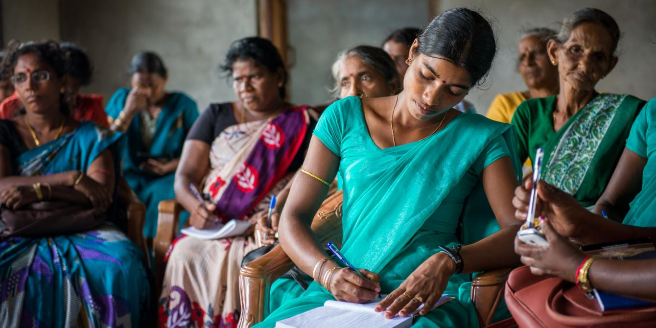 Women at a community learning session. Photograph: Oxfam.