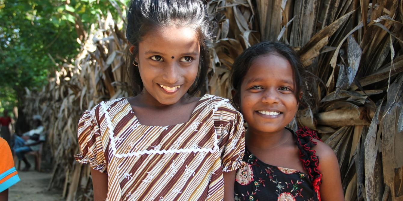 Happy children from an Oxfam assisted community. We work our partners to assist the poor and disadvantaged communities. Photograph: Oxfam