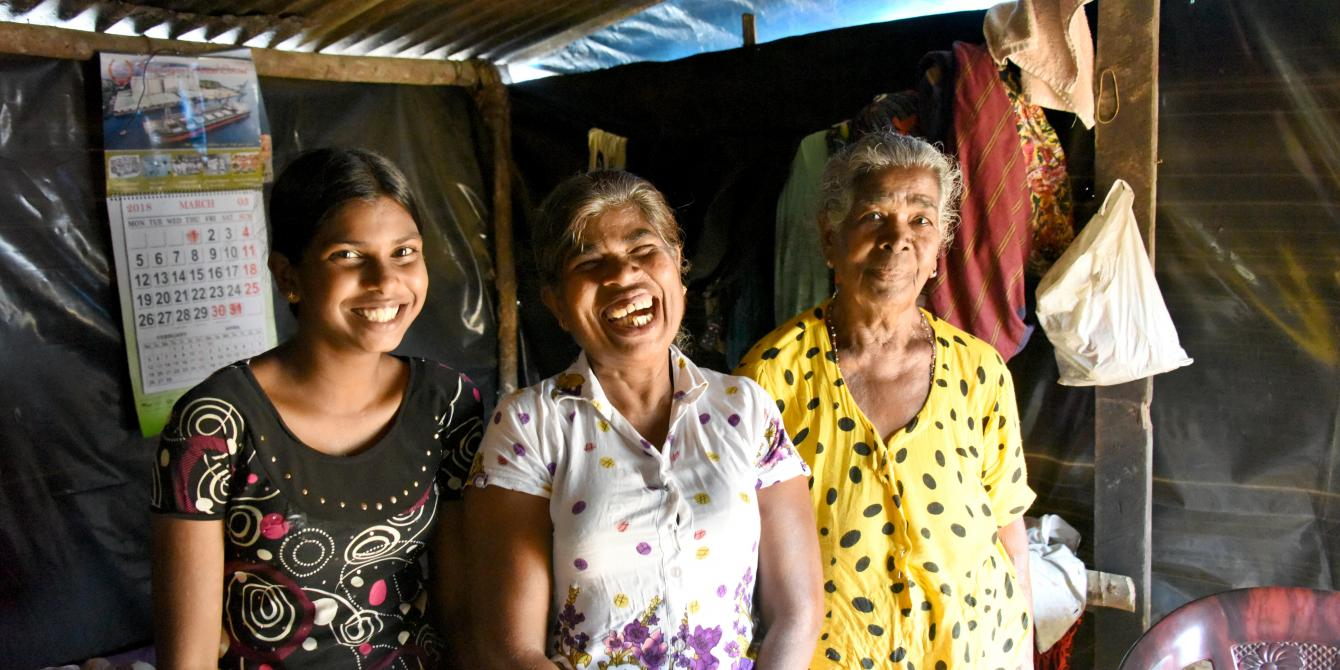 Three females, youth, middle-aged woman, elderly lady, all laughing